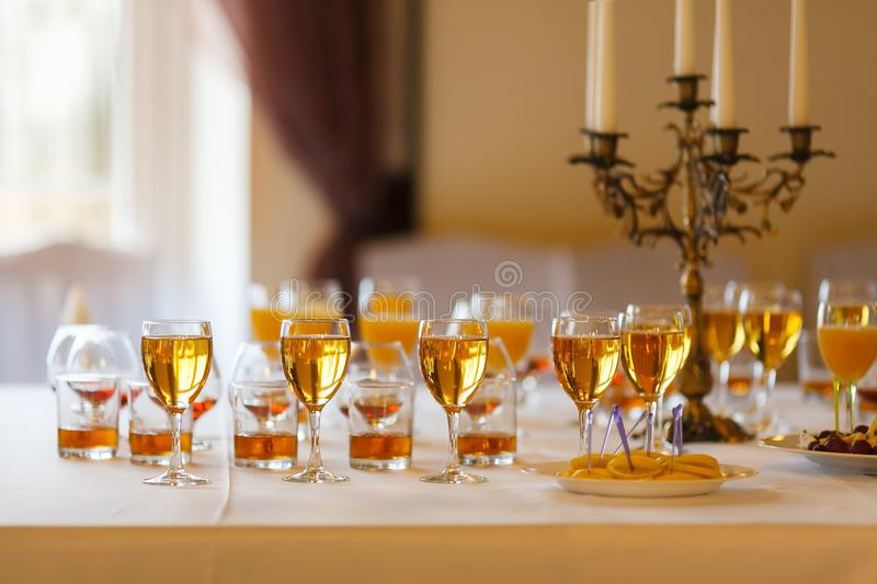 Lot of glasses of wine, juice and whiskey on the buffet table royalty free stock images