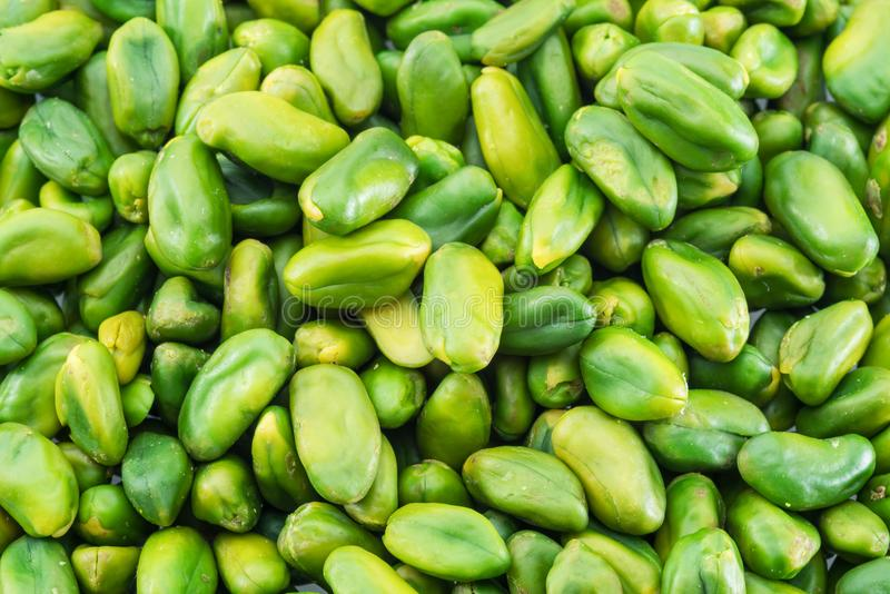 Lot of green pistachio nuts. Food background. royalty free stock photos