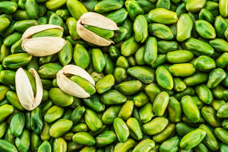 Lot of green pistachio nuts. Food background. royalty free stock images