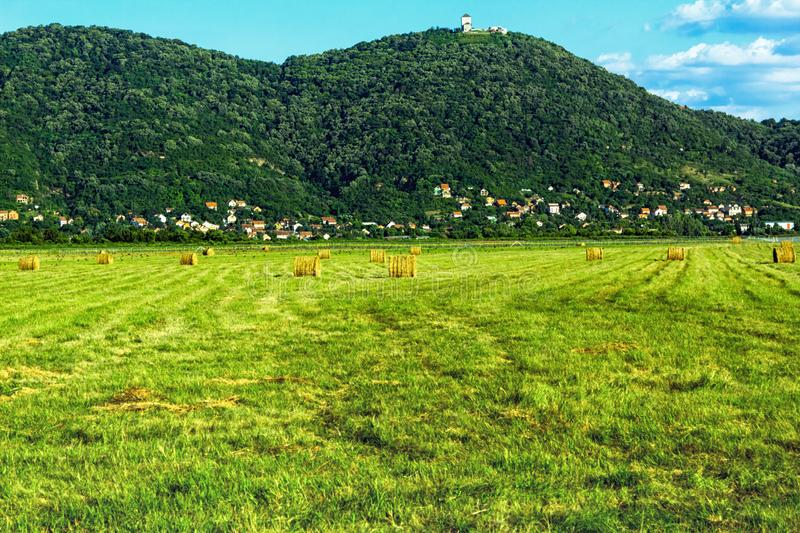A lot of haystacks and panorama of the city royalty free stock photos