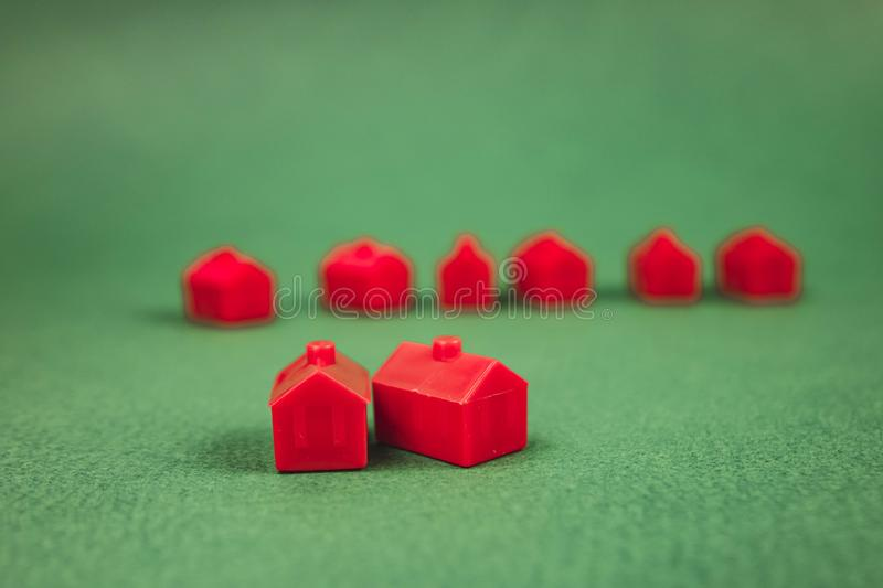A lot of houses, red on green background stock photography