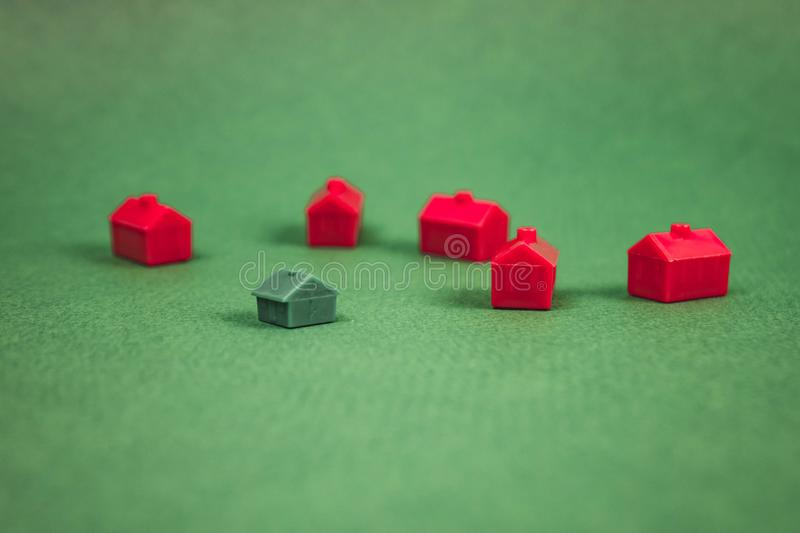 A lot of houses, red and green. Concept, toy, miniature, background, family, business, design, tree, construction, home, housing, property, town, village stock images