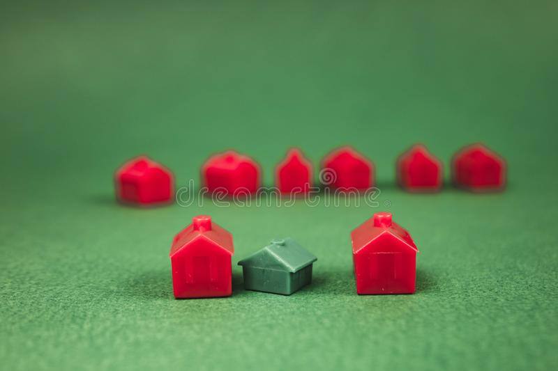 A lot of houses, red and green. Concept, toy, miniature, background, family, business, design, tree, construction, home, housing, property, town, village stock image