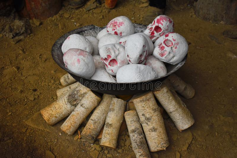 A lot of human skulls. Cannibalism. Primitive customs and Ancient tribes stock image