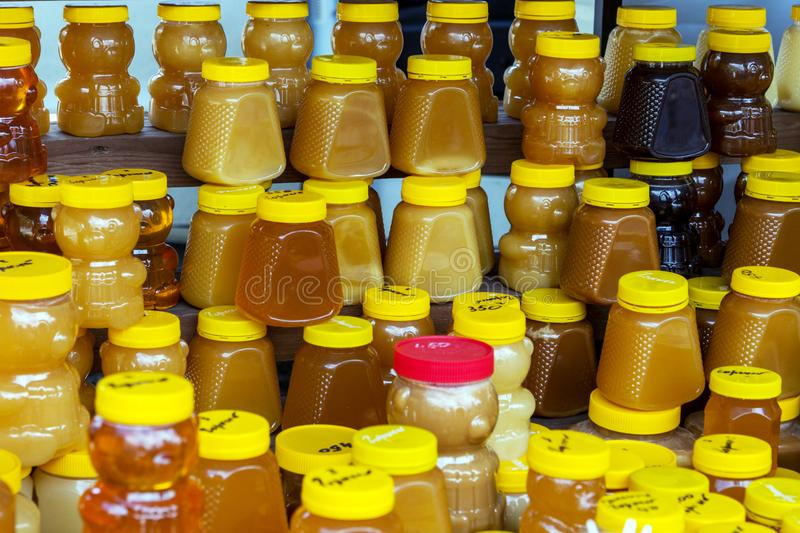 Lot of jars of different types famous Altai honey stock photography