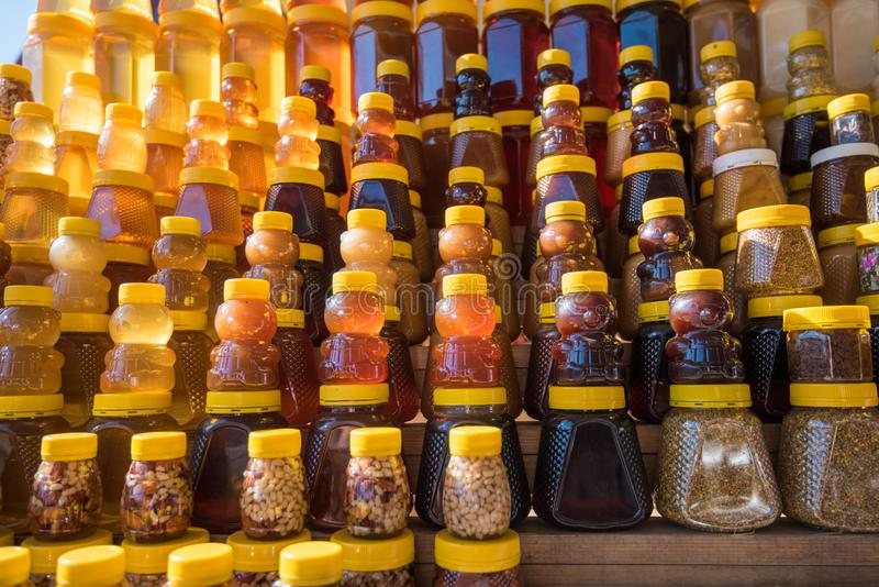 A lot of jars with natural organic honey royalty free stock photo