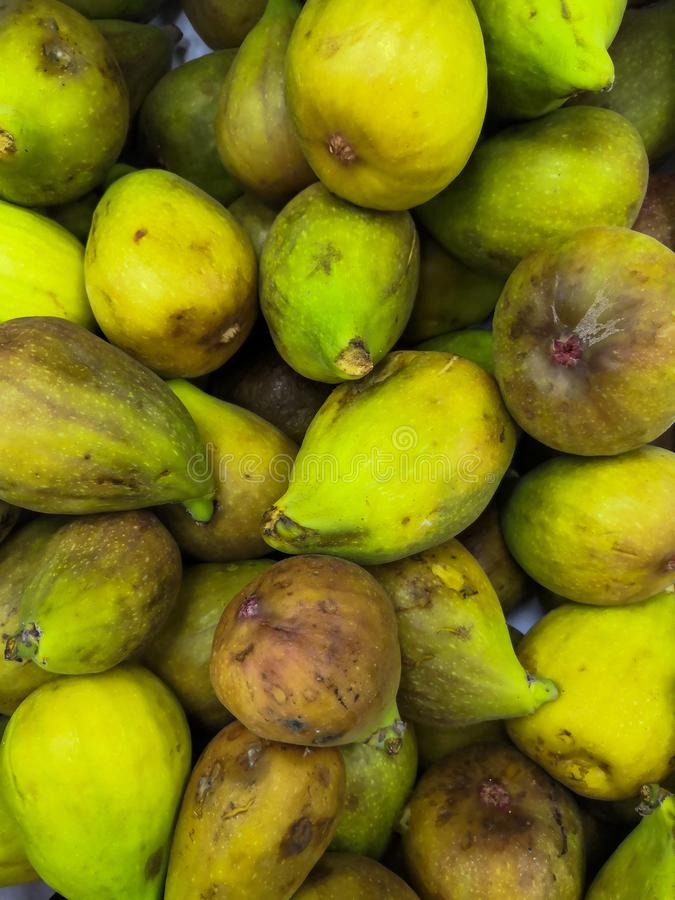 A lot of juicy, sweet, appetizing figs on the market in the summer in the city of Maikop Republic of Adygea royalty free stock images