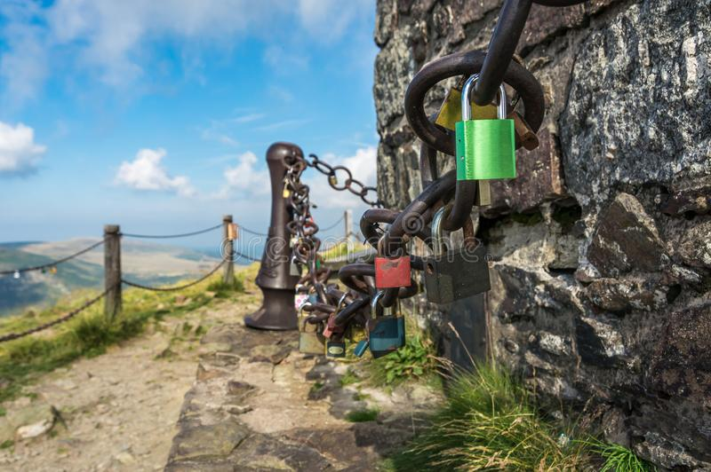 A lot of love padlocks on chain - romantic concept of love stock photo