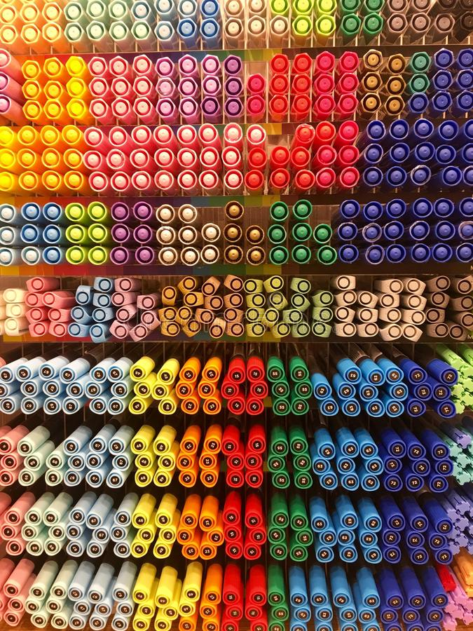 A lot of markers are on the shelf in the store. Color spectrum of markers. A lot of colored markers royalty free stock images
