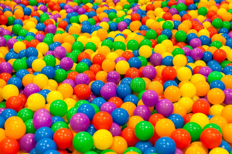 A lot of mini colorful ball in the pool stock photos