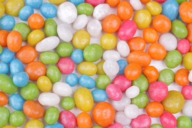 Multicolored round candy on a white background. Top view. stock photos