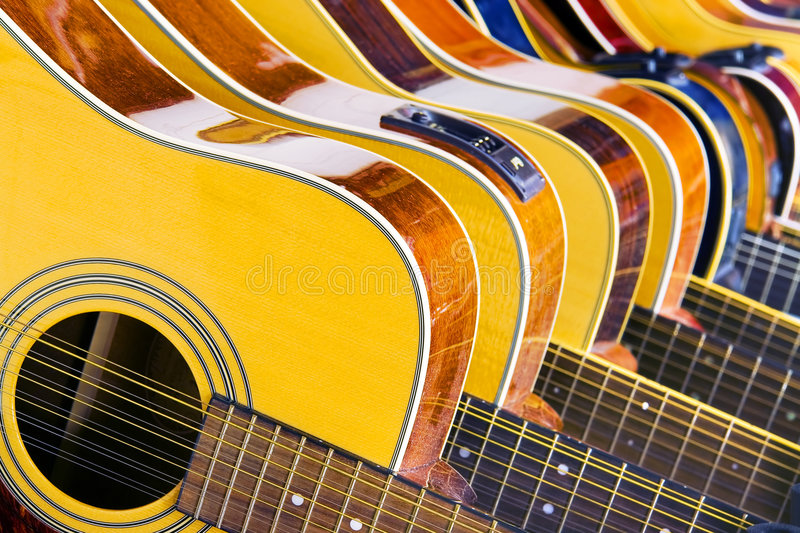 Lot Of Music. (10 Different Acoustic Guitars In A Row stock photography