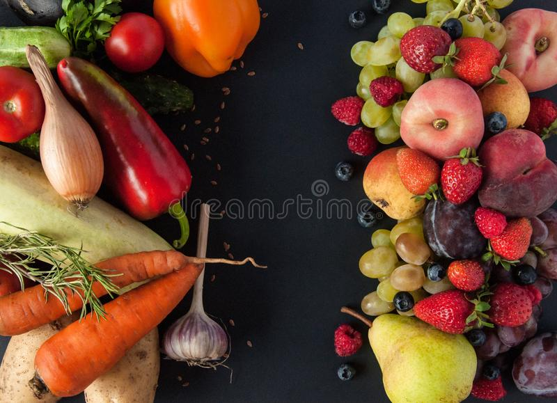 A lot of natural and healthy vitamin fruits, berries and vegetables natural products on a black background. Vegan eco safe food. stock photos