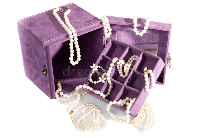 Lot of necklace pearl in jewerly box purple with bracelet vintage royalty free stock photo