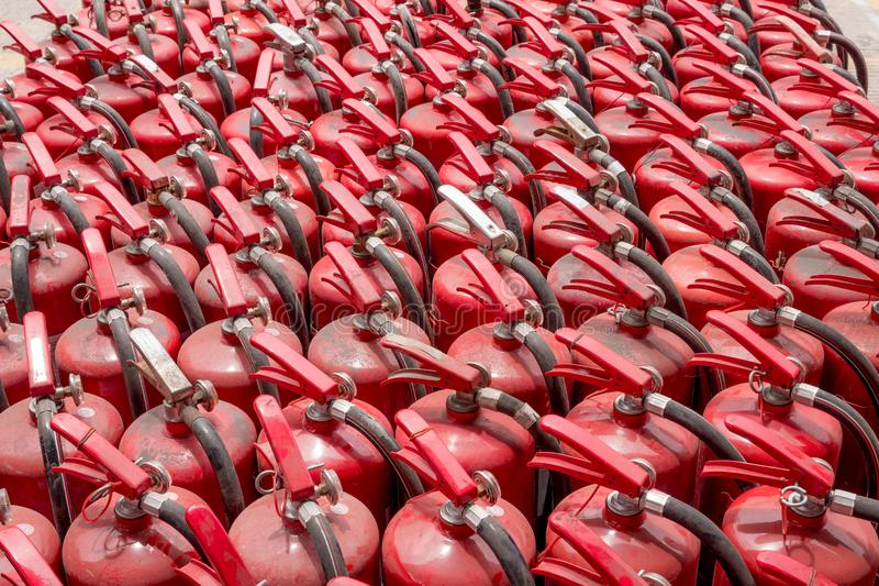 A lot of old fire extinguishers. stock images
