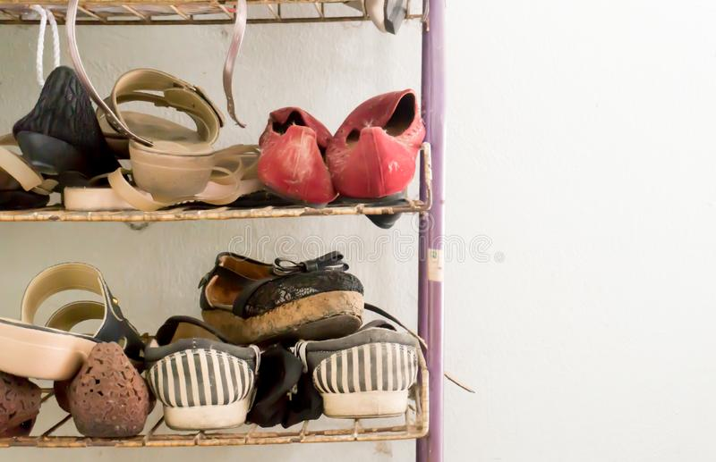 A lot of old shoes. A lot of old shoes background stock photo