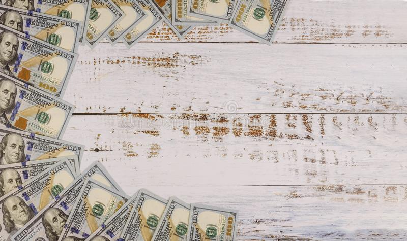 One hundred dollar bills on wooden background. A lot of one hundred dollar bills on wooden background, currency, banking, exchange, wages, financial, wealth stock photography