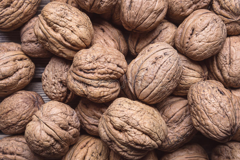A lot of organic walnuts. Nature background. Top view. stock photos