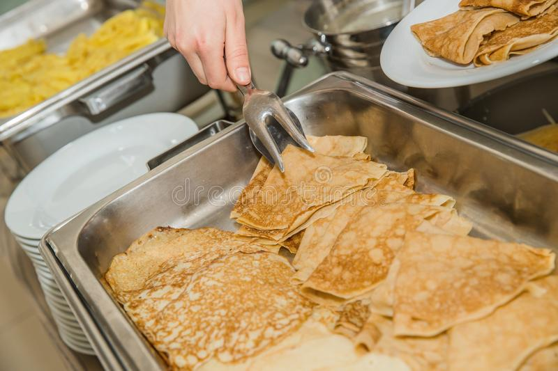 A lot of pancakes with different fillings on a baking sheet. royalty free stock photography