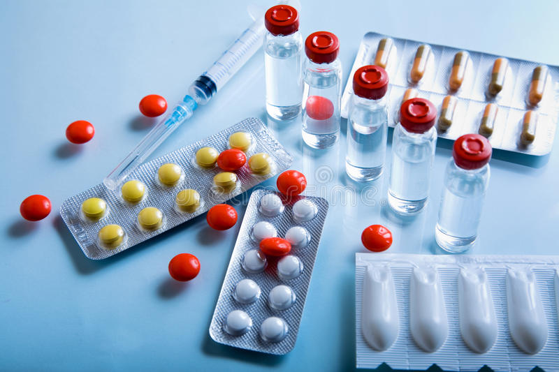 Lot of pharmaceutical products. Syringe and pills royalty free stock photos