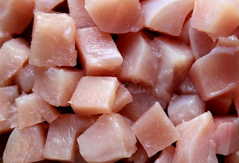 A lot of pieces of raw syrup for cooking. Chicken, meat, raw, isolated, background, fillet, texture, food, preparation, pieces, fresh, closeup, macro, protein stock image