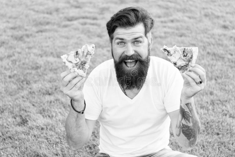A lot of pizza. bearded man hipster eat pizza. happy man student eating pizza. having fun. dieting will wait. summer royalty free stock image