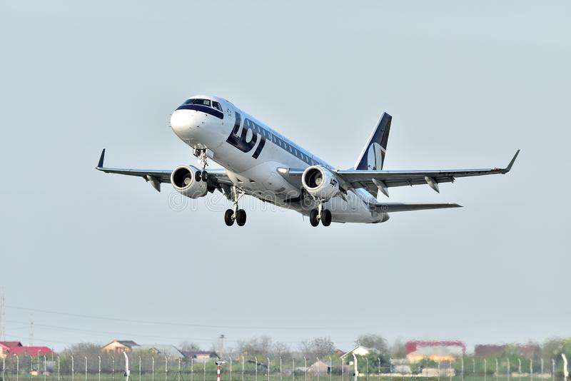 LOT polish airlines commercial airplane takeoff from Otopeni airport in Bucharest Romania. Plain spotters close up stock photos
