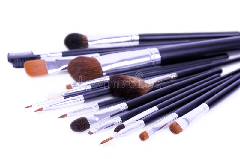 A lot of professional make-up brushes on white stock photography