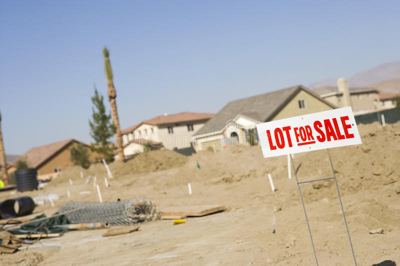Lot For Sale. Sign at an empty land royalty free stock photos