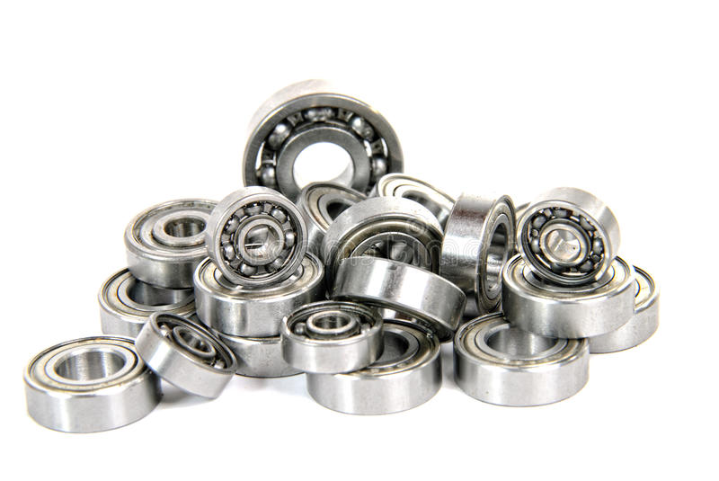 Lot of small ball bearings. On the white background stock photo
