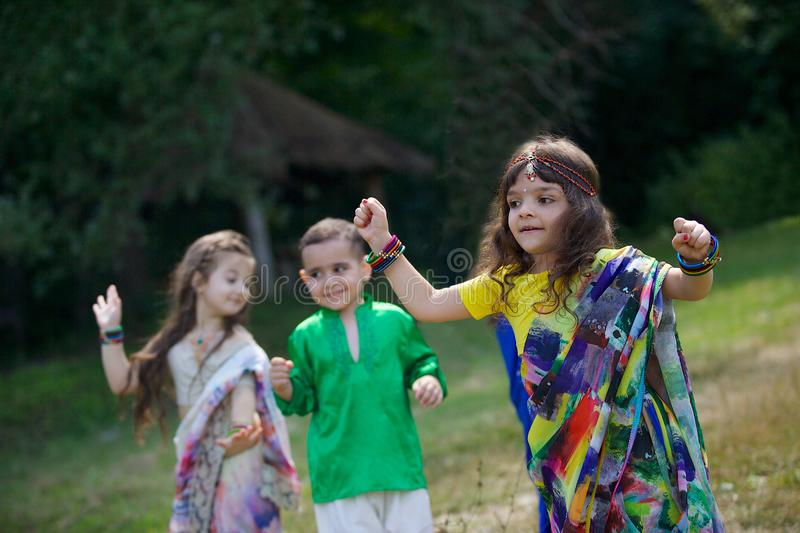 A lot of small children, boys and girls, dressed in the clothing royalty free stock photography