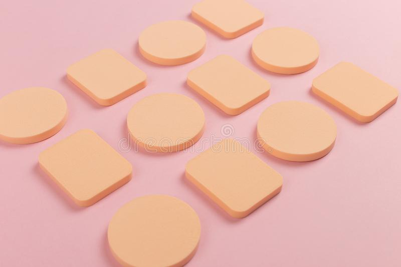 A lot of sponge, a beautiful blender for applying foundation or powder. Flat lay on a pink background, copy space. Square, nobody, texture, makeup, base stock images