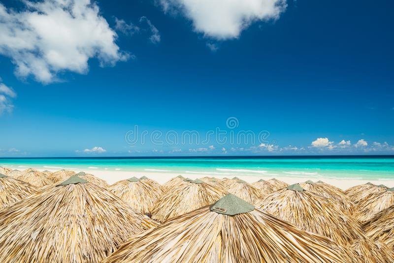 Straw beach umbrellas from above royalty free stock photos