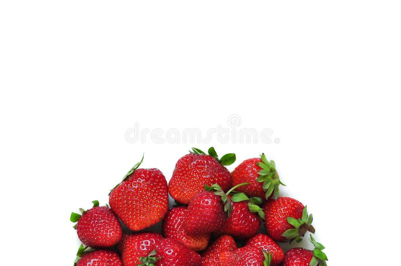 A lot of strawberry berries on a white background. A group of sweet fruits. Vitamin fruits for smoothies, cocktails and preserves. royalty free stock photos