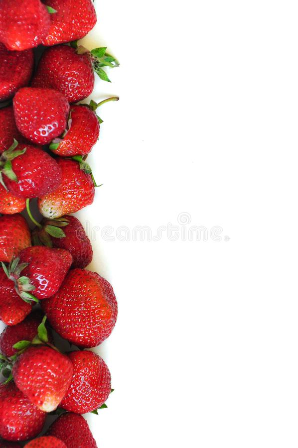 A lot of strawberry berries on a white background. A group of sweet fruits. Vitamin fruits for smoothies, cocktails and preserves. royalty free stock photography
