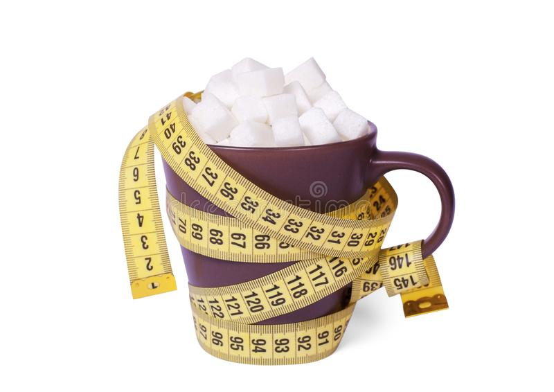 Lot of sugar leads to obesity and diabetes. Cup of coffee or tea to top full of sugar cubes and wrapped in yellow measuring tape royalty free stock image