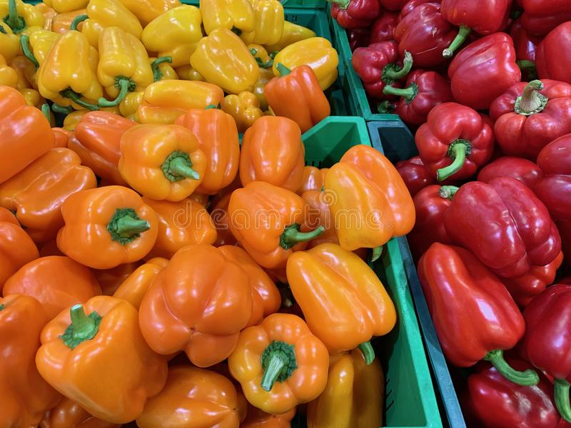 Red, yellow, orange pepper. Many in the market. royalty free stock photo