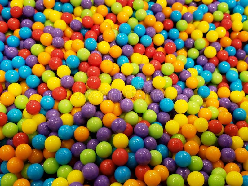 Lot of sweets full of color and high sugar content, background and texture stock images