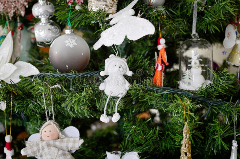 A lot of things are hanging on the Christmas tree: Santa Claus, Bells and Balls, Gingerbread man and Candy canes, Snowman. A lot of things are hanging on the royalty free stock photo