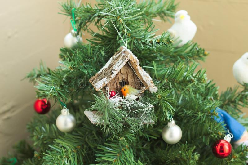A lot of things are hanging on the Christmas tree: Santa Claus, Bells and Balls, Gingerbread man and Candy canes, Snowman. A lot of things are hanging on the stock photo