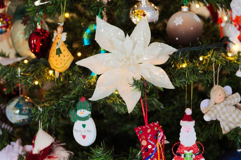 A lot of things are hanging on the Christmas tree: Santa Claus, Bells and Balls, Gingerbread man and Candy canes, Snowman. A lot of things are hanging on the royalty free stock photography
