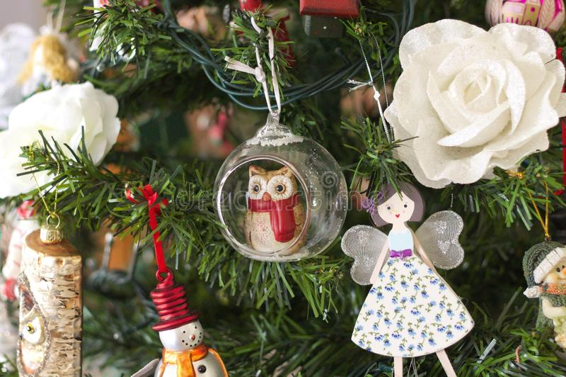 A lot of things are hanging on the Christmas tree: Santa Claus, Bells and Balls, Gingerbread man and Candy canes, Snowman. A lot of things are hanging on the royalty free stock image