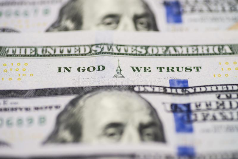 A lot of 100 US dollar bills banknotes. In god we trust. Bill hundred US dollars closeup phrase in god we trust royalty free stock photo