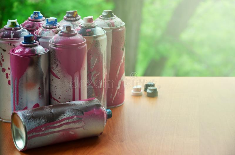 A lot of used spray cans of paint close-u royalty free stock photos