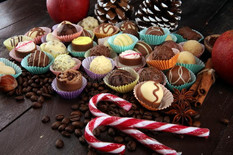 A lot of variety chocolate pralines, belgian confectionery gourmet chocolate and christmas spices with apples royalty free stock image