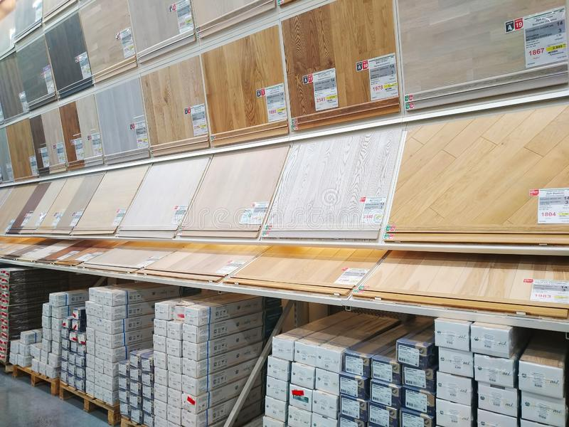 A lot of various floorboard are sold in a large building materials store Leroy Merlin royalty free stock photography