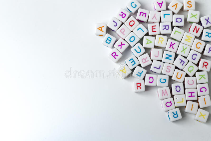 A lot of white cubes with letters on a white background. Many decorative white cubes with letters on a white background stock photography