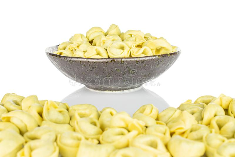 Spinach filled tortelloni isolated on white stock photos
