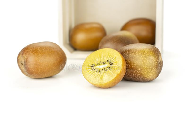 Fresh golden brown kiwi fruit sungold isolated on white royalty free stock photo