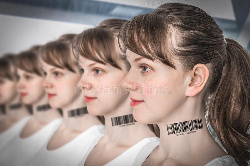 A lot of women in a row with barcode - genetic clone concept royalty free stock image